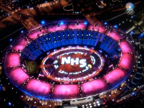 "London Olympics: ""an opening ceremony for the 99 percent"" The CSMonitor observes that the Opening Ceremony of last night's London Olympics seemed to be ""an opening ceremony for the 99 percent:""    It is more than a little bit presumptuous to imagine that Mr. Boyle was sending coded political messages to American voters who can't hear the words ""universal"" and ""health care"" in the same sentence without invoking the Commerce Clause. But that doesn't mean Boyle didn't have a message. He insisted that message was not political, but rather a reflection of the values that British society holds dear and emanates to the world.  ""One of the reasons we put the NHS in the show is that everyone is aware of how important the NHS is to everybody in this country,"" he said at a press conference earlier in the day. ""One of the core values of our society is that it doesn't matter who you are, you will get treated the same in terms of health care."" […] Is that political? That is in the eye of the beholder.  But it is hard to escape at least some small sense of advocacy in Boyle's second act, particularly after a cigar-chomping elite let loose the gluttony of unchecked industry on the idyllic English countryside in the first act. This was, it seemed, an opening ceremony for the 99 percent.  In some respects, that gave it a poignancy beyond opening ceremonies of Olympic past – Boyle actually had a cutting message, whatever you thought of it.    If one day Obamacare does for Americans what the NHS does for the British, we'd be overjoyed to celebrate it with light-up beds and dancing nurses and doctors too. Imagine the idea of ""it doesn't matter who you are, you will get treated the same in terms of health care"" not being radicalized by one political party which decided, long ago, that protecting the financial interests of corporate insurance (and the overcompensated CEOs in charge of it), is their first priority. In a truly ""Christian"" society, outlandish profits for insurance companies in exchange for only some being able to afford health care would be out of the question. I'm glad to see other industrialized nations chose to be humane. It gives me hope that maybe someday we will too. View Post shared via WordPress.com"