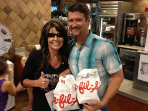 think-progress:  Sarah Palin gives a thumbs up to anti-gay Chick-fil-A.  We're going to eat a moose in protest.