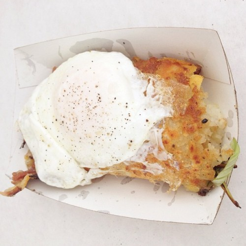 At the Egg booth with a $12 egg over easy, hashbrown, cheddar, braised bacon, and scallion gut-bomb. You only live once, right? #food #breakfast (Taken with Instagram at Smorgasburg)