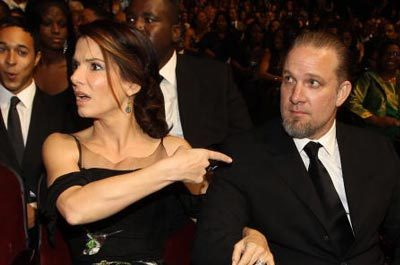 sandra bullock pointing fingers at jesse james.