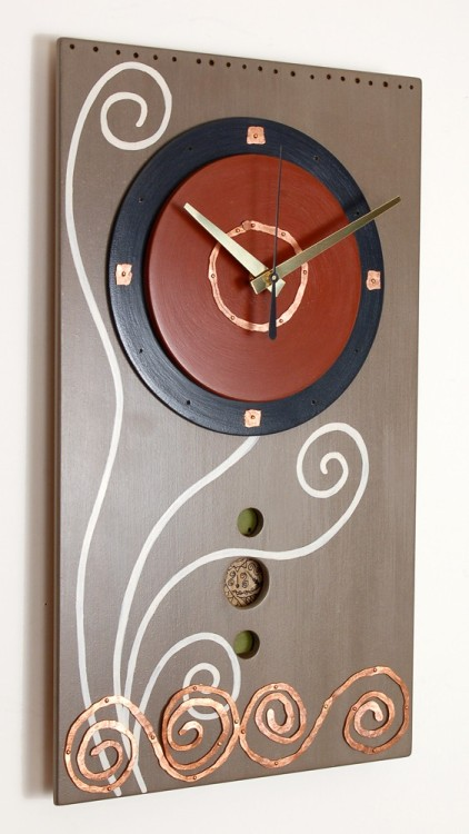 Cucuteni pendulum wall clock by mary potts Cucuteni was the name given to the culture whose artifacts were found in this region of Romania. The word comes from the Romanian word for hemlock. I'm fascinated by the swirl motifs found painted on Cucuteni pottery dating from the Neolithic Period. The people of the Cucuteni region appear to have had an egalitarian society.