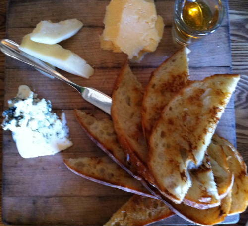 Delightful cheese trio paired with sourdough toast and honey at Haddingtons American Tavern on W. 6th Austin.