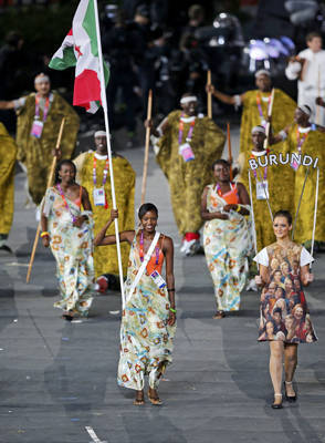 Burundi's flagbearer Diane Nukuri holds the national flag as she leads the contingent in the athletes parade during the opening ceremony.