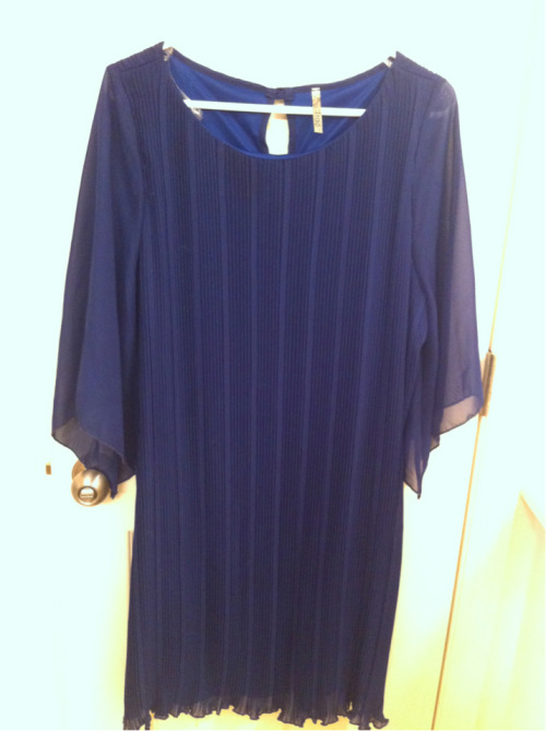 This is the Goddess Accordion dress from Redress/NYC, I got it as a back up for my brother's wedding but didn't wear it. It has a little tie to give the waist definition. I think it would look super cute with a white patent leather belt also.