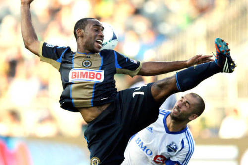 High-flying kick!  Philadelphia Union's Amobi Okugo and Montreal Impact's Marco Di Vaio vie for a header.