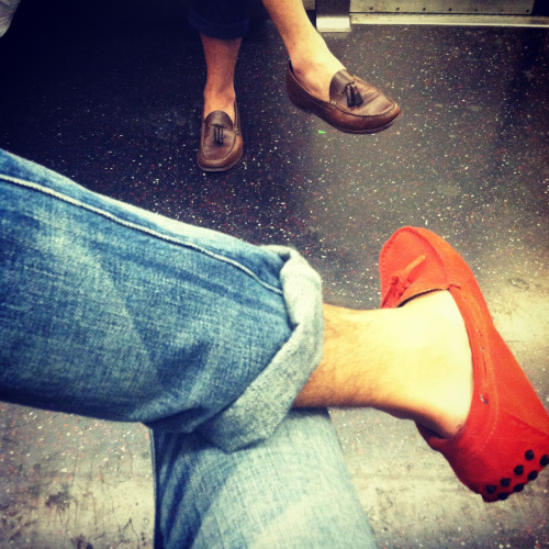 A boy about town in his red suede moccasins.