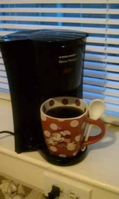 my new best friend. coffee and my minnie mug (it has its own spoon).