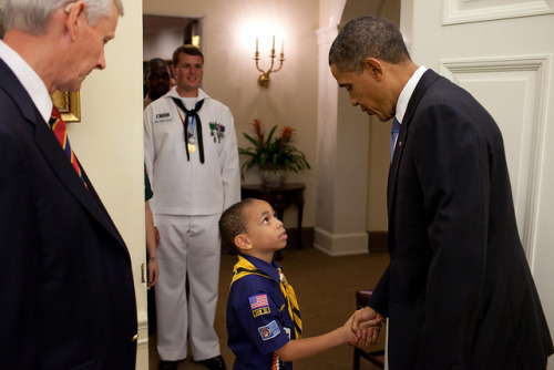President Barack Obama shakes hands with Cub Scout Raphael Cash from Bowie, Md., prior to a meeting with a group of Boy Scouts of America youth members and executive leaders in the Oval Office, July 12, 2010. (Official White House Photo by Pete Souza)