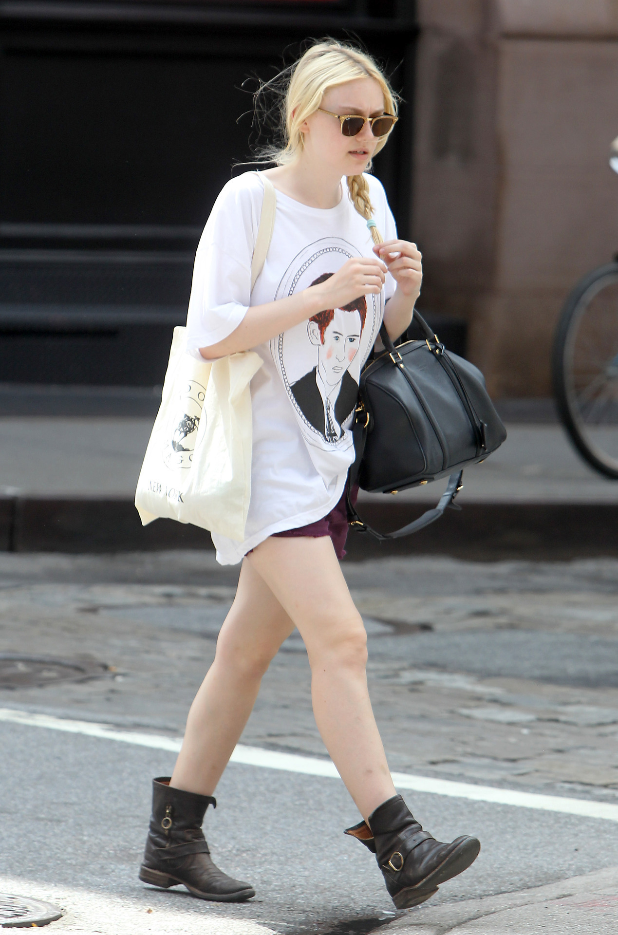 Dakota Fanning wearing a Deer Dana Prince Harry t-shirt in Soho, July 27th