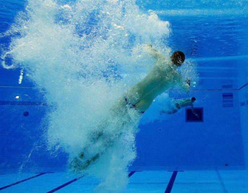 Olympic Diver. {Tom Daley}  losing his trunks again.
