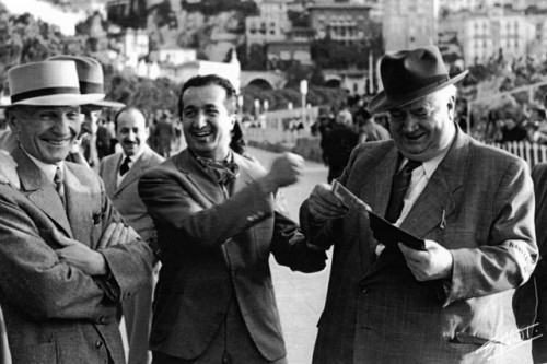 Legendary Italian designer Vittorio Jano, dual world champion Alberto Ascari and the mastermind behind both the pre and post-war dominant Mercedes teams Alfred Neubauer. Jano was famed for designing legendary cars such as the Alfa Romeo P3, Alfa Romeo 158/159 Alfetta, Lancia D50, and the original Ferrari 206 Dino road car, named in honour of Enzo Ferrari's late son. Jano took his own life in 1965 after falling ill, months after the death of his own son. Despite losing his father to motor racing (in a car designed by Jano), Ascari would go on to have great success, equalling his father's number of Grand Prix victories, but also passing away in a similar way to his father at the same age (only a matter of days after this photo), also leaving behind two children and a wife. In his short career, he won two driver's championship in dominant fashion for Ferrarin in 1952 and 53, and still holds seven different records fifty years later. Alfred Neubauer was the brainchild behind the dominant pre and post Mercedes teams, winning a slew of Grand Prixs and Driver's championships. He retired when Mercedes withdrew from motorsport after the tragedy at Le Mans in 1955. He died at the age of 89 in Stuttgart in 1980.