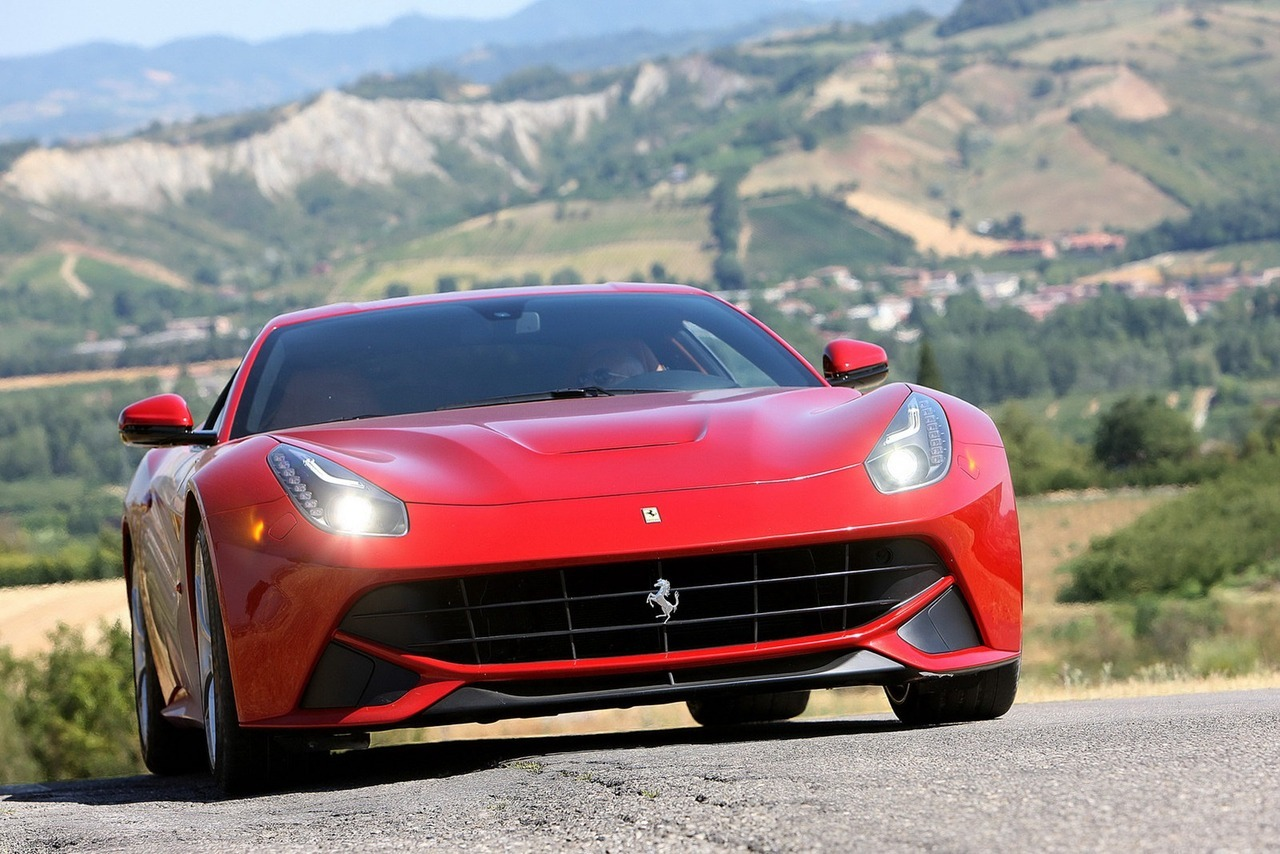 "2013 Ferrari F12berlinetta  Ferrari claims the F12berlinetta is not only the most powerful road car ever built in Maranello, with its 6.2-liter V12 engine delivering 730hp (740PS) and 690Nm (509 lb-ft) for a 0-200 km/h (124 mph) acceleration time of 8.5 seconds and a 340 km/h+ (211mph+) top speed, but also the most potent in the 2012 Fiorano Presentation with a lap time of 1'23"".   (vía Carscoop)"