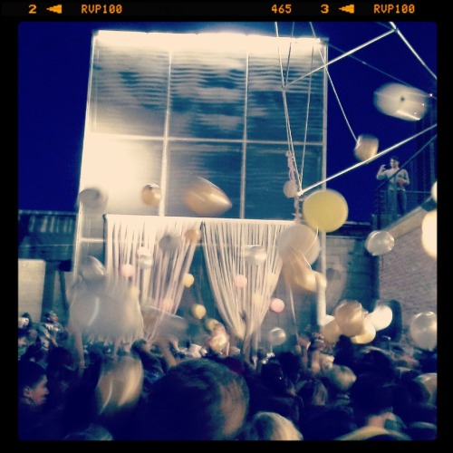 rhymeswithcat:  Bleached performing as balloons descend from the sky