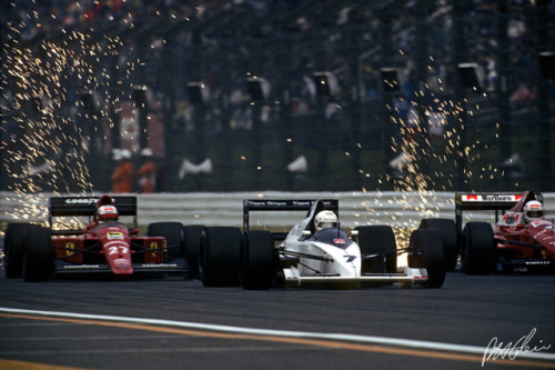 Sparks fly as Nige, Brundle and de Cesaris share the same piece of road at Japan in 1989. A race better known for a collision between a pair of red-and-white cars.