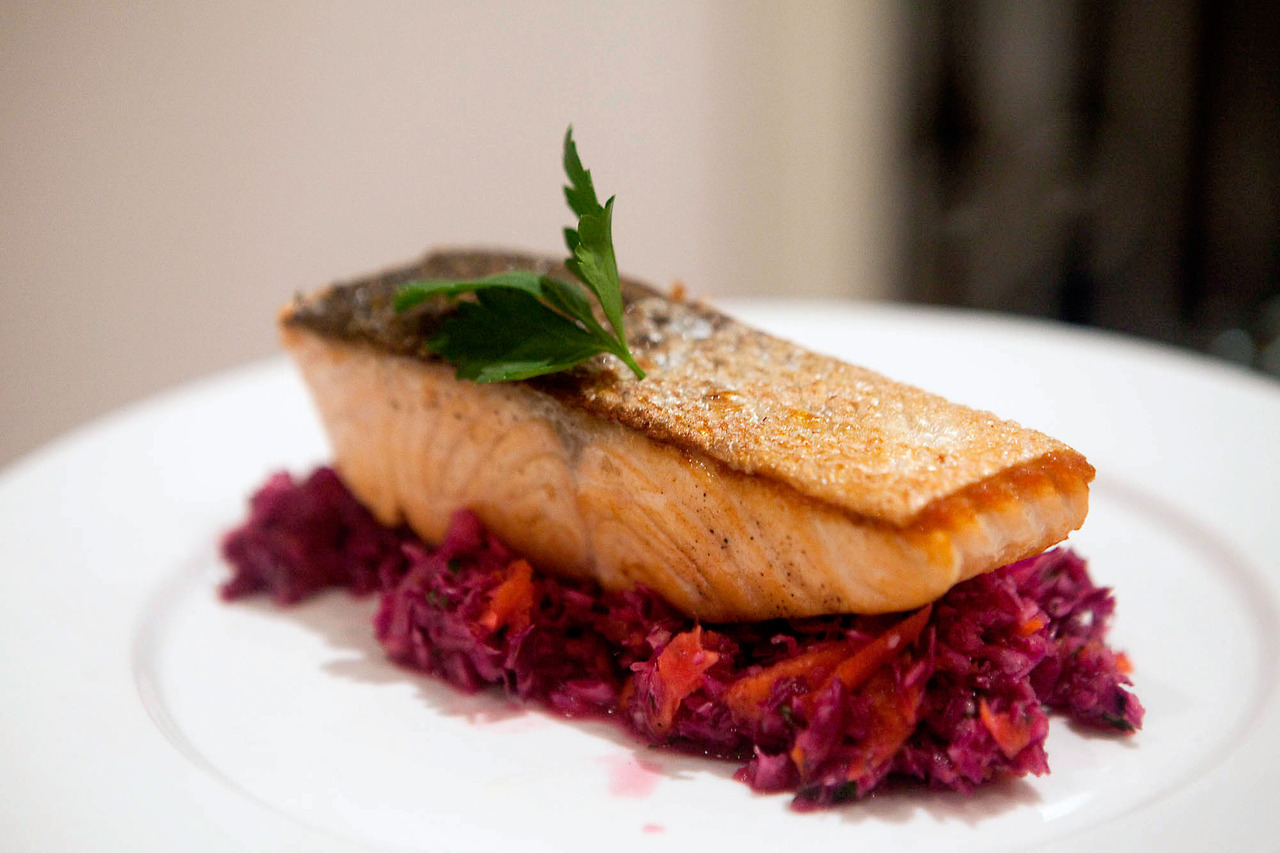 "Seared Salmon with Cabbage and Carrot SlawThe slaw was a really nice, simple recipe from Chow, that makes a heap of food.  I used a whole onion, doubled the lime juice, added 1/4 cup of apple cider vinegar, and used mint instead of cilantro.  I probably used 2 or 3 times more salt and pepper as well, but it made double what you see in the photo on the Chow site (maybe 10 times as much as you see in my photo.  Be warned, you'll be seeing a lot of this for the next week).The salmon I seasoned with salt and pepper, and started in a cold pan, flesh side down, with a bit of olive oil.  Turn the heat to medium high and cook for about 7 minutes, flip, and cook for 7 more minutes, depending on how ""done"" you like your salmon."