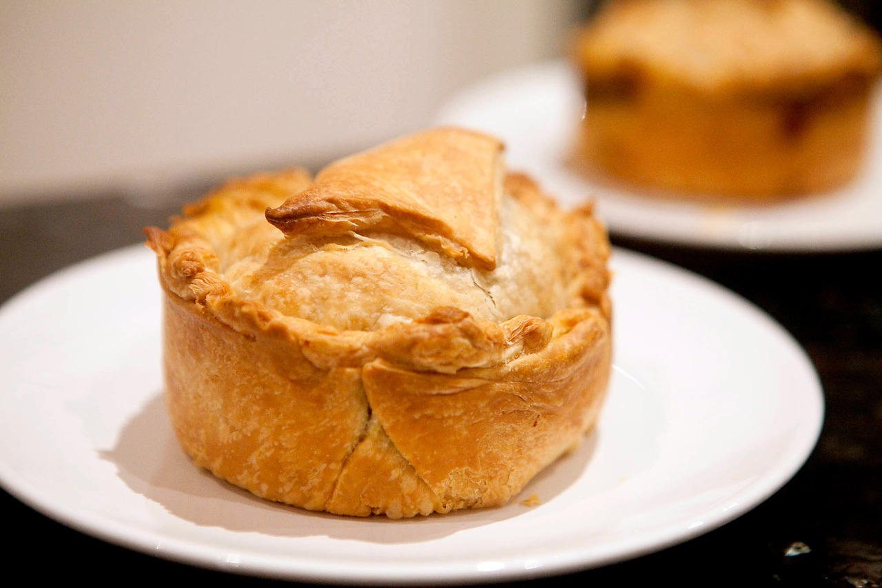 Tasmanian Curried Scallop Pie This should be a no-brainer, but don't buy frozen scallops from Chinatown.  Any Chinatown.  Maybe if you know what you're doing (if so, please share!), but which fresh scallops this take on a Tasmania Scallop Pie would be a winner.  These were quite a bit spicier and not as creamy as the ones I had when I was down there, but aside from the scallop situation, I liked them better. The true test will be whether the ones I froze hold up, those I just assembled and popped in the freezer.  Hopefully they're a better version of a frozen meat pie, but I'll report back on that. Ingredients (serves 8): 2 cups of fresh scallops 1 cup of frozen, thawed peas 1 large potato, boiled and chopped 2 tbsp of Roasted Curry Powder 2 tbsp grated ginger 1 tsp cinnamon 1 tsp tumeric 1 tsp ground coriander 1 tsp sweet paprika 1 cup of coconut milk 3 tbsp tomato paste 1 tbsp tamarind paste 1 onion, diced 3 garlic cloves, diced 1 chili, diced Juice of 1 lime 2 sheets of frozen puff pastry, thawed 3 sheets of frozen shortcrust pastry, thawed Saute the onion and garlic until soft.  Add the scallops and cook for 2-3 minutes.  Add the chili and spices, and cook for a few minutes before adding the rest of the ingredients.  Cook on low for 20 minutes, until the curry is thick, and then let cool completely. Line the bottom of 8 pie dishes with shortcrust, fill with the curry, then top with puff pastry, sealing with a bit of water and then joining the 2 by pressing around the edges with a fork.  Cook immediately, or freeze.  To reheat the frozen ones, just put directly in the oven.