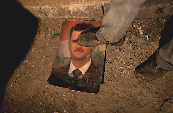 A picture of President Bashar al-Assad of Syria under the boot of a member of the Free Syrian Army, a group fighting to oust him. Syria After the Fall There is no easy way out of such a stalemated struggle, and this one threatens the stability of the whole Middle East. So the United States and its allies must enlist the cooperation of Mr. Assad's allies — Russia and, especially, Iran — to find a power-sharing arrangement for a post-Assad Syria that all sides can support, however difficult that may be to achieve. Until now, Washington has seen the developments in Syria as a humiliating strategic defeat for Iran, and it has largely sat on the sidelines, trying to draw diplomatic cooperation from Russia. The administration and its critics alike may think that involving Iran in any resolution to the conflict would throw Tehran a lifeline and set back talks onIran's nuclear program. But a breakup of Syria — and the chain of events that such a breakup would inevitably set in motion — poses a graver threat to the Middle East and to America's long-run interests in the region than does Iran's nuclear program. And Iran has much more influence with the Assad leadership than does Russia. If the Syrian conflict explodes outward, everyone will lose: it will spill into neighboring Lebanon, Jordan, Iraq and Turkey. Lebanon and Iraq in particular are vulnerable; they, too, have sectarian and communal rivalries tied to the Sunni-Alawite struggle for power next door. In the past week, Mr. Assad has lost control of important parts of the country, and the opposition, buoyed by outside sympathy and support, has built on the momentum of a bombing in Damascus that killed key security aides to the president. The shift in balance is significant, but it is not decisive. Rather, it sets the stage for a protracted conflict that would divide Syria into warring opposition and pro-Assad enclaves.