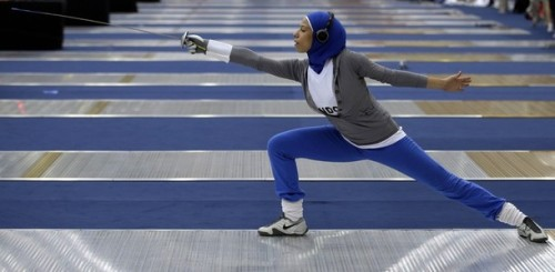 thebengalcat:  Egypt's fencer Eman Gaber trains in the ExCeL center at the London 2012 Olympics, Thursday, July 26, 2012. (AP)