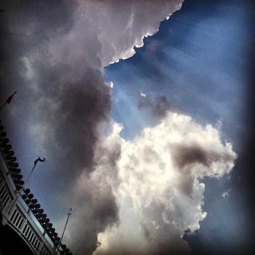 #Sun and storm #clouds at #YankeeStadium. #GodsRays #baseball #NYY #MLB #Bronx #NYC #scenery #flags #summertime  (Taken with Instagram at Yankee Stadium)