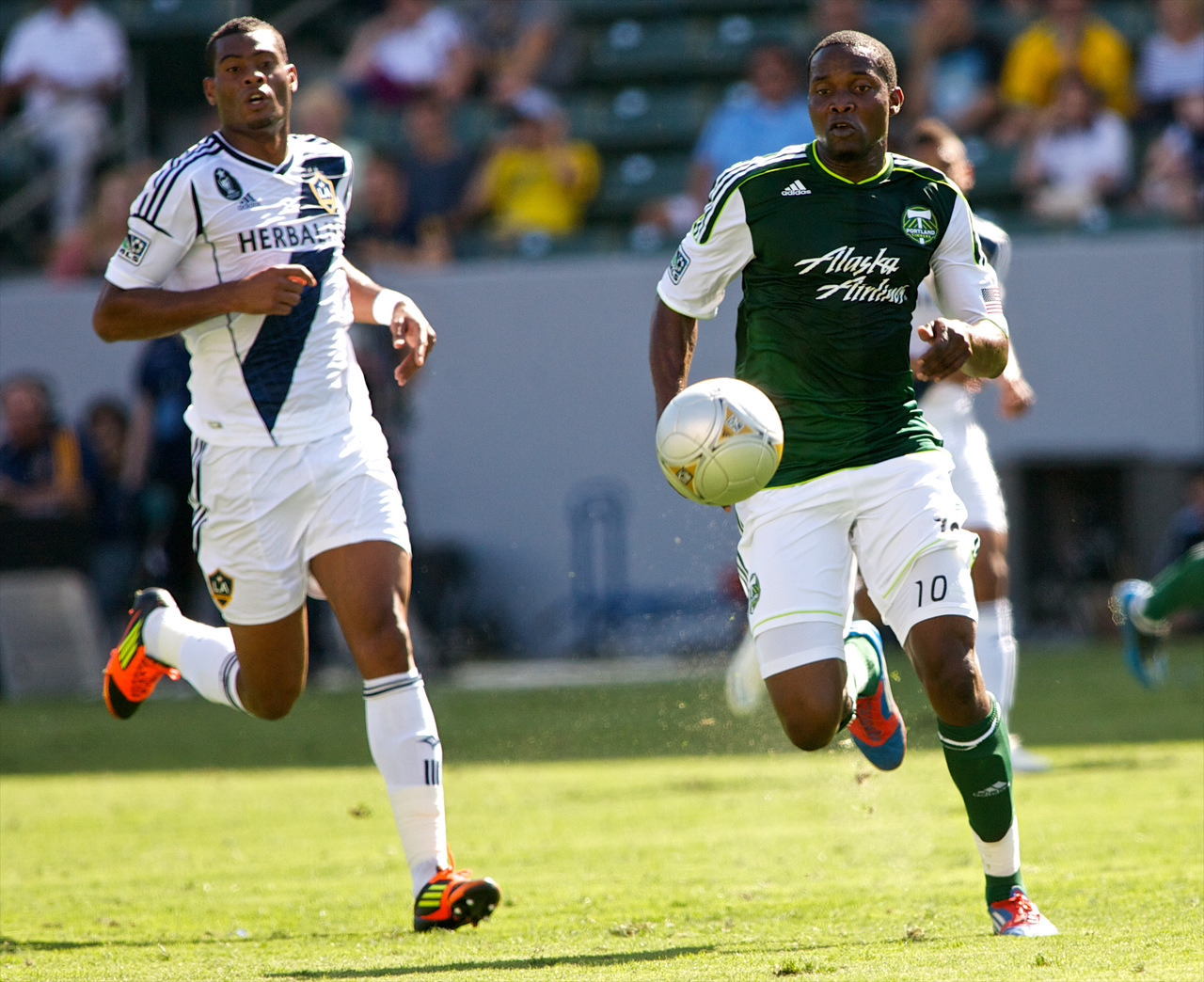 Portland Timbers forward Danny Mwanga chasing a ball earlier this season against the LA Galaxy. Born in Kinshasa, Mwanga moved to the United States after the death of his father in the Congolese civil war. In issue one of XI Quarterly, Andrew Guest talks to Mwanga as part of his larger analysis of why immigrants tend to succeed in American soccer - and in society as a whole. Photo: Craig Mitchelldyer/Portland Timbers