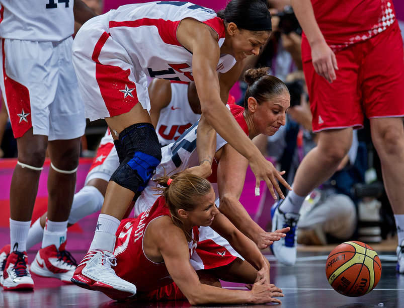 Diana Taurasi and Candace Parker of the USA wrestle Iva Ciglar of Croatia for the basketball during preliminary round action. The U.S. team overcame a sloppy start and breezed to a 81-56 victory. (John McDonough/SI) GALLERY: Vote on the best photos from Day 2 | Day 1VIDEO: Review all the action from Day 2 in London