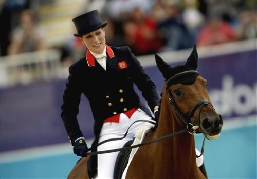 """Zara Phillips, of Great Britain, and her horse High Kingdom, exit the ring after competing in the equestrian eventing dressage phase at the 2012 Summer Olympics, Sunday, July 29, 2012, in London. David Goldman / AP Photo"" HOOVES UP FOR ZARA :D"