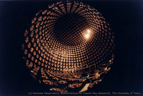 fou-a-lier:  The Super Kamiokande (Kamioka Neutrino Detection Experiment) is a neutrino observatory located under Mount Kamioka in Japan. It is designed to observe solar and atmospheric neutrinos, neutrinos from supernovae, and aims to search for proton decay. It is a cylindrical structure measuring about 40 m tall and 40 m across, is covered in over 11,000 photomultiplier tubes (PMTs), and filled with 50,000 tons of pure water. Neutrinos weakly interact with other particles, making it extremely difficult to detect them and observe their properties; in fact, they cannot be directed detected at all. Detectors are built underground to isolate it from other radiation. When a neutrino passes through the Super-K's water tank, it will sometimes (hopefully) collide with a quark, causing it to change into a charged lepton (electron, muon, or tau). The very short version of what happens next is that the lepton will travel faster than the speed of light in water (not in vacuum), polarizing the water molecules; when they return to their ground state, Cherenkov radiation is emitted in a flash of light, which the PMTs detect. The last image is of a Cherenkov ring by an electron created from a neutrino collision in the Super-K, in perspective view.