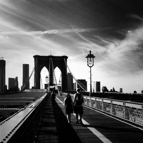 "Walking across the Brooklyn Bridge in the late afternoon. New York City.  In the light of the afternoon, the city stretches out across its bridges into the promise of evening's suggestion of night.  —-  This photo was taken with my phone. I am @newyorklens on Instagram (view my feed here).  Check out my other Instagram posts made to this blog here. You can check out all of my Instagram photos on Flickr here. Additionally, you can view my phone photography for sale here.  —-  View this photo larger and on black on my Google Plus page   —-  Buy ""Walking Over the Brooklyn Bridge - New York City"" Prints here, My mobile photography for sale here, My regular photography for sale here, email me, or ask for help."