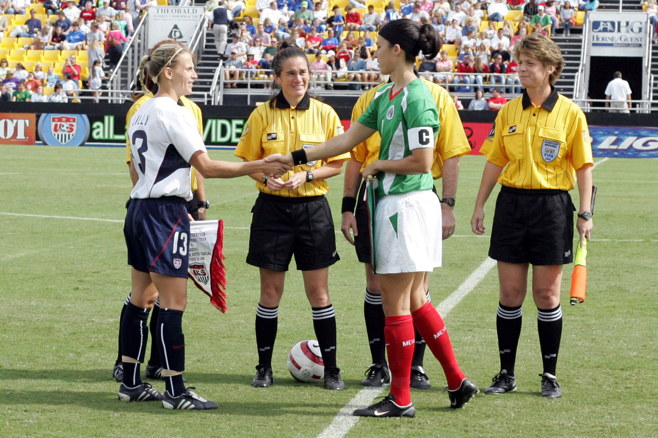 "xiquarterly:  Mexican captain Monica Gonzalez pictured above shaking hands with USWNT captain Kristine Lilly at an October 2005 international at Blackbaud Stadium in Charleston. Born in Corpus Christi, Texas, in issue one of XI Quarterly she talks to Jeff Kassouf about her experiences as an American-born star for the Mexican national women's soccer team.  ""I can tell you right now, I never would have gotten 89 caps [with the U.S.]."" Gonzalez says. ""Never.""  Photo Credit: Scott Bales/YCJ Subscribe now to XI Quarterly and receive a special introductory offer"