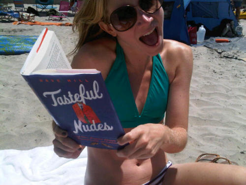 This is Clare Tucker totally reading my book at the beach.  Or at Burning Man.  I'm not sure.  Either way it's incredible.  Keep up the good work, Clare!