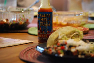 "Hot sauce from hell on fish tacos. One of our latest culinary adventures. Note that I didn't dare have any after the three boys at the table agreed in that it had some ""kick"" to it."