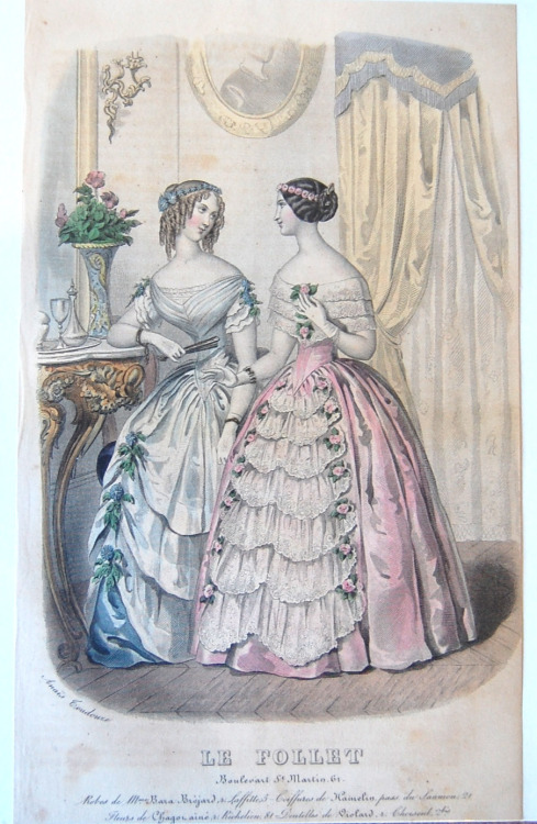 "rskelly:  Antique fashion plate, hand colored. From Le Follet fashion magazine, drawn by the artist Anais Tondouze. I am not sure the year this was printed, but they are wearing crinolines rather than bustles of the later part of the 19th century. The ""61"" may indicate it is from 1861. Evening wear."