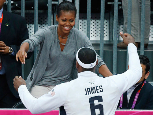 stayroyal:  First Lady Michelle Obama hugs the U.S. Men's Basketball team one by one after defeating France 98-71 in the preliminary round.