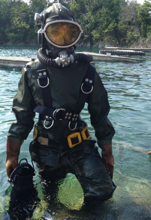 paranoidsheep:  Me in a 1950's era vintage Soviet Spy scuba suit! The top part folds down so that the divers could pop their heads out to shoot at targets. I was testing it out for a diving museum.It had a little wiper in the goggles to make sure the mask didn't get fogged up, which was fun to use. It was heavy and a little claustrophobic because I couldn't get out of it myself, and if there was a problem with the breathing system I would have to wait for them to get me out while the CO2 built up. But it was fun!  Old, but awesome!