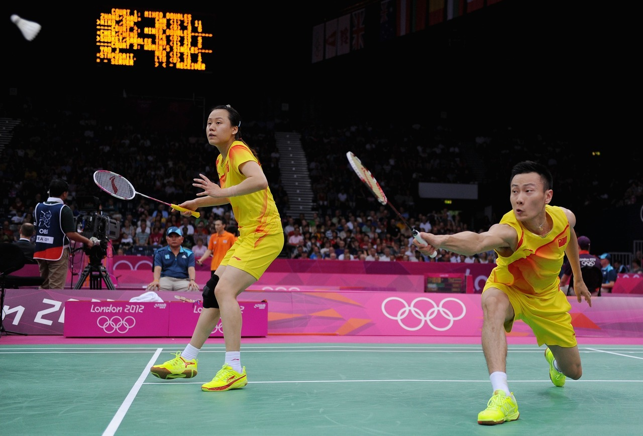 Nan Zhang (R) and Yunlei Zhao (L) of China return a shot against Alexandr Nikolaenko and Valeria Sorokina of Russia during their Mixed Doubles Badminton on Day 2 of the London 2012 Olympic Games at Wembley Arena. Photo by Michael Regan/Getty Images