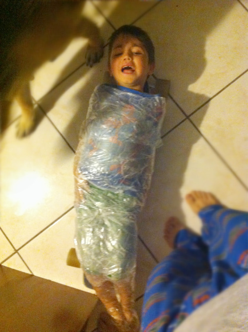 simonwang:  My nephew taped his little brother to my nieces skateboard..