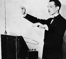 Leon Theremin demonstrates his invention.