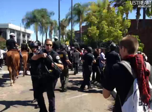 isaacking99:  #OWS @OccupyWallSt protesters getting violent towards #Anaheim police, arrests happening, guns up!