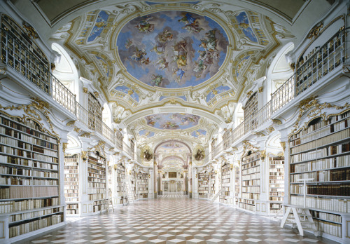 "Admont Abbey (Stift Admont) is a foundation of the Benedictines on the River Enns in the town of Admont in Austria and is the oldest remaining monastery in Styria. It contains the largest monastic library in the world and a long-established scientific collection, and is known for its Baroque architecture and collections of art and manuscripts. The library hall, built in 1776 to designs by the architect Joseph Hueber, is 70 metres long, 14 metres wide and 13 metres high, and is the largest monastery library in the world. It contains c. 70,000 volumes of the monastery's entire holdings of c. 200,000 volumes. The ceiling consists of seven cupolas, decorated with frescoes by Bartolomeo Altomonte showing the stages of human knowledge up to the high point of Divine Revelation. Light is provided by 48 windows and is reflected by the original colour scheme of gold and white. The architecture and design express the ideals of the Enlightenment, against which the sculptures by Joseph Stammel of ""The Four Last Things"" make a striking contrast. The abbey possesses over 1,400 manuscripts, the oldest of which, from St. Peter's Abbey in Salzburg, were the gift of the founder, Archbishop Gebhard, and accompanied the first monks to settle here, as well as over 900 incunabulae."
