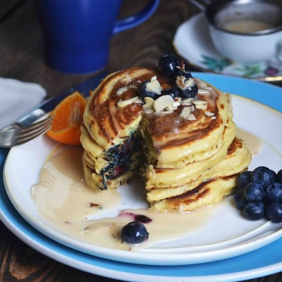 Blueberry almond pancakes with maple syrup, yum!