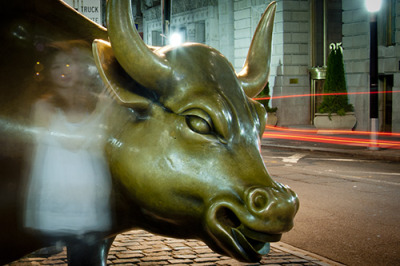 This is the Charging Bull sculpture near Wall Street. It was originally a piece of illegal street art following the stock market crash of 1987. The artist: Arturo Di Modicia made it at a cost of 360,000 and dropped it off near Wall St.. The bull was immediately seized by the NYPD and placed in an impound lot, until the public outcry over the incident forced them to put this gift back at the top of Bowling Green Park and leave it there. http://en.wikipedia.org/wiki/Charging_Bull