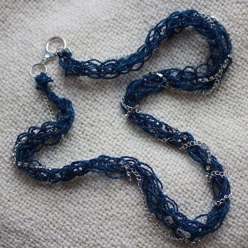 truebluemeandyou:  DIY Finger Knitting Chain Necklace Tutorial from stripes + sequins here. I've gotten another question about what projects you can do with finger knitting and this is a really easy one. Really clear series of photos showing you how to finger knit. *For a roundup I made of finger knitting posts go here.