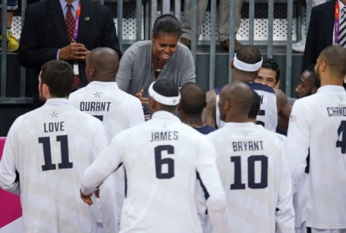 US basketball players are congratulated by US First Lady Michelle Obama after they won 98-71 the Men's Preliminary Round Group A match United States vs France at the London 2012 Olympic Games , on July 29, 2012 in London.