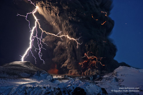 inothernews:  CRACKLE AND POP  Lightning bolts illuminate a column of ash pouring out of the Eyjafjallajökull volcano on April 14, 2010.  (Photo: Sigurður Stefnisson via NASA APOD)
