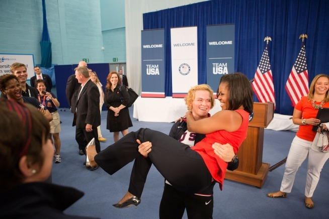 Image description: First Lady Michelle Obama is picked up by U.S. Olympic wrestler Elena Pirozhkova during a visit with Team USA Olympic athletes competing in the 2012 Summer Olympic Games. View more photos from the First Lady's trip to London. Photo by Sonya N. Hebert, Official White House