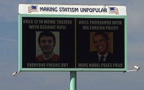 "thecallus:  theatlantic:  This Is the Obama-Aurora Billboard Everyone's Talking About [Image: The Hollywood Reporter]  Sanctioned v. unsanctioned violence.  ""That's a technique of trying to make a point, and maybe it was poorly done."" — Maurice Clements, the guy behind this billboard."