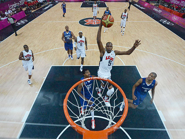 Kevin Durant swoops in for a dunk during Sunday's men's basketball game between the USA and France. Durant poured in 22 points to lead the U.S. team while Kevin Love added 14 points and Kobe Bryant contributed 10. The U.S. team will next face Tunisia on Tuesday. (John McDonough/SI) THOMSEN: U.S. finds its blueprint for gold in win over FranceMANNIX: Thunder trio working to turn page in London