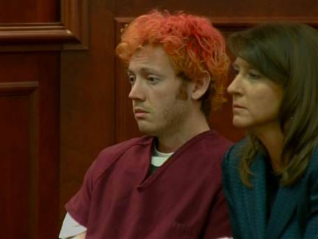 "James Holmes charged with murder in Colorado theater shooting James Holmes was charged with 24 counts of murder Monday in the deaths of 12 people at a Batman movie premiere in Aurora, Colo.  The murder charges included 1 count of murder, and 1 counts of ""murder of extreme indifference,"" for each of the victims, according to NBC's Mike Taibbi.  Read the complete story."