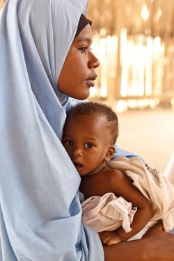 SAHEL FOOD CRISIS - Niger, 2012: Farida Ousmane, 16, holds her 9-month-old brother, Laouli Ousmane, at the UNCEF-supported Routgouna Health Centre, in the town of Mirriah, Mirriah Department, Zinder Region. They are waiting for Laouli, who is malnourished, to be examined. With prompt global support, a full-scale nutrition crisis can still be averted. - © UNICEF/NYHQ2012-0176/Olivier Asselin The Sahel covers parts of the territory of (from west to east) Senegal, southern part of Mauritania, Mali, southern part of Algeria, Niger, Chad, southern part of Sudan and Eritrea. It is bordered on the north by the Sahara and on the south by the less arid Savannah.