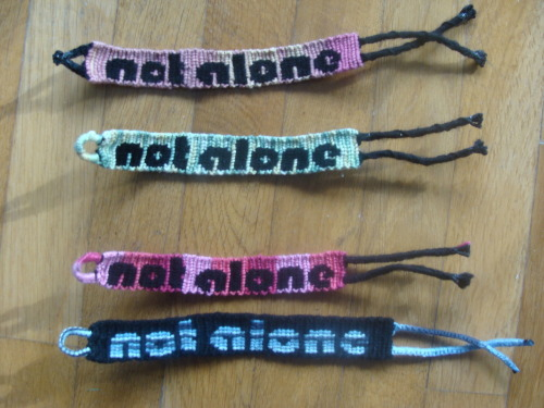 The Not Alone bracelets in a better quality, as promised. ^.^ The battery charger from the videocamera was found, so, yay!